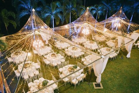 Transparent canopies with white chiavari chairs