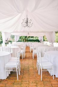 White canopies with white chiavari chairs