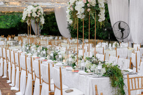 Transparent canopies with gold chiavari chairs