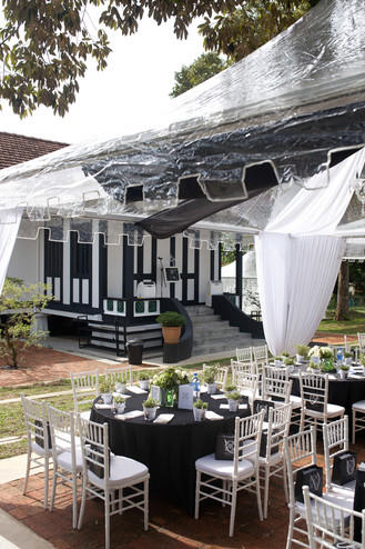 Transparent canopies with black table linen and white chiavari chairs