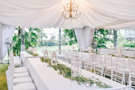 White canopies with viking table setting and white chiavaris