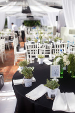 Transparent canopies with black tablen linen and white chiavari chairs