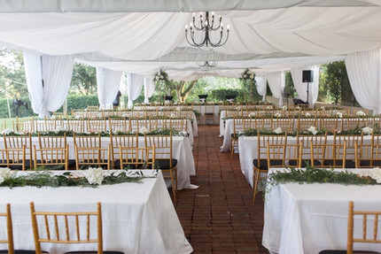 White canopies with gold chiavari chairs
