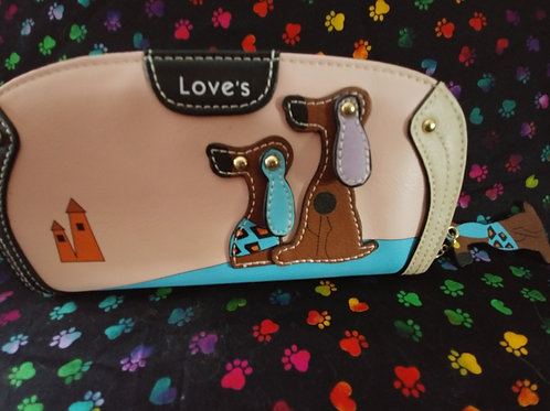 Vegan wallet, adorable doggies including the pull zipper.  Lots of space.