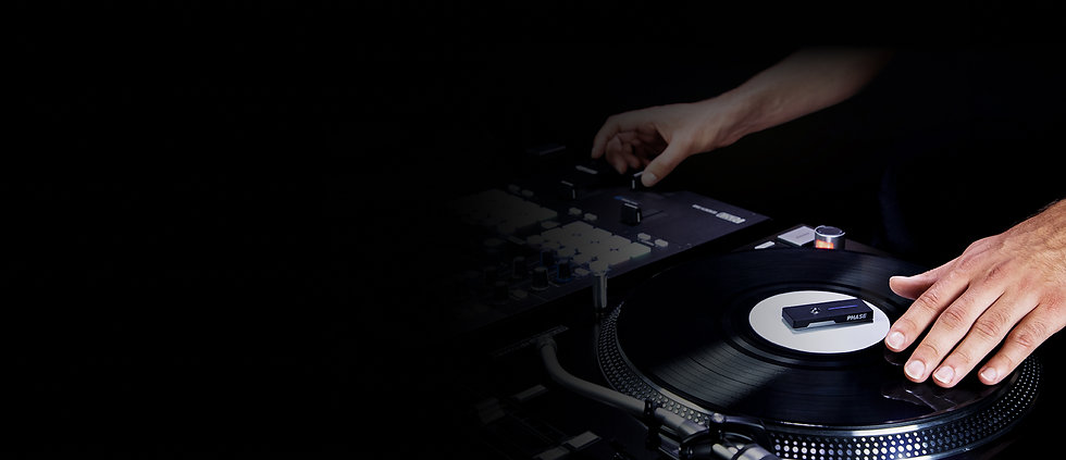 A DJ is mixing with a Phase Remote on a vinyl record