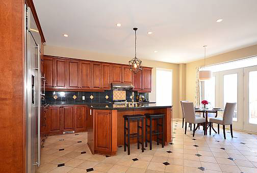 Open Concept Kitchen with Oak Cabinets