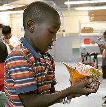 student learning conch bahamas nassau atlantis marine education initiative