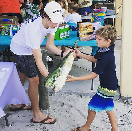 fish donated feeding hungry mahi child giving