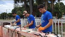 feeding hungry fish donate charity nonprofit florida marine education initiative