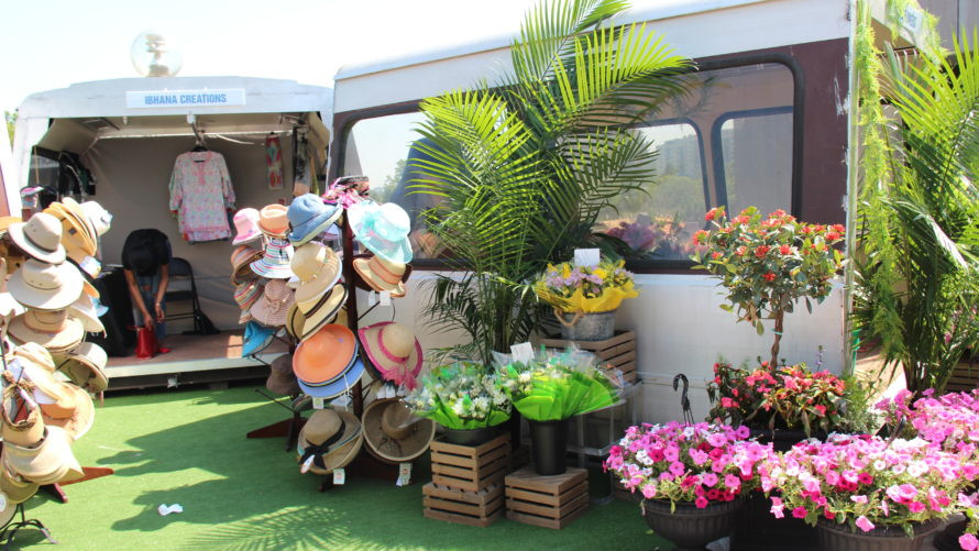 Flowers bloom in an old Metro car at the Grosvenor-Strathmore pop-up retail plaza. Mikaela Lefrak / WAMU