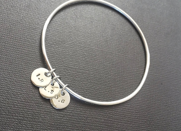 Sterling Silver name bangle with multiple charms