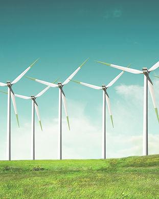 Windmills on green field