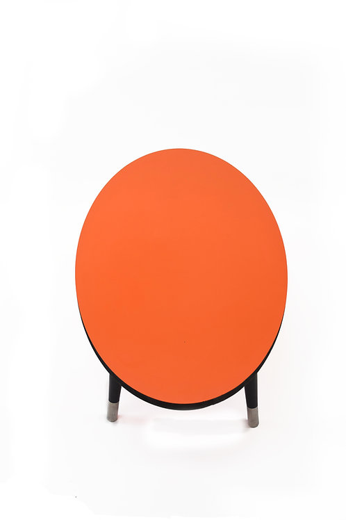 Oval Orange top coffee table with black edge,tapered legs and stainless steel fe