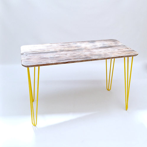 Modern industrial looking table with yellow hairpin legs