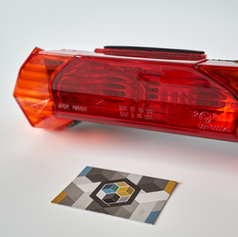 Indicator lens on lighting unit