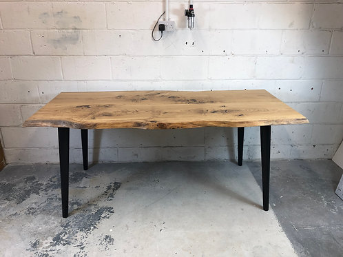 Live edge solid oak dining table with 2 wooden slabs and 4 wooden angled tapered