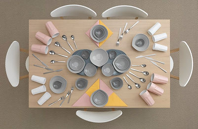 This is one of Carl Klimier's images for an ikea campaign. a set of grey coloured dinnerware spread out on a peach coloured table, creating an abstract painting.
