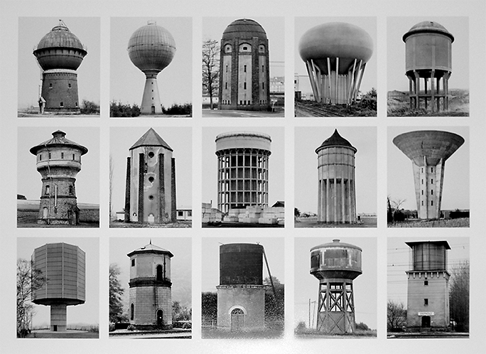 A typological series of Watertowers photographed in black and white by Bernd and Hilla Becher. This image shows fifteen watertowers in a grid formation of five images across and three down.