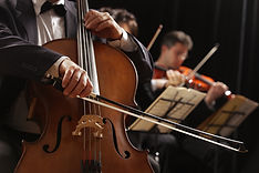 Cello player in orchestra