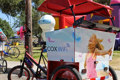 Pedicab wrapped with the Cox wifi graphics