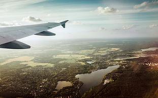 plane-wing-in-sky-over-landscape.jpg