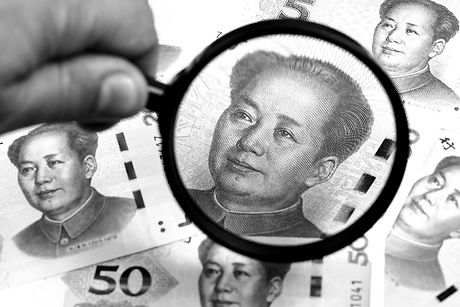 chinese-yuans-in-a-magnifying-glass-RBHD4PU_edited.jpg