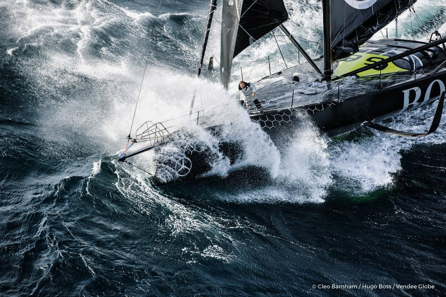 alex-thompson-in-the-hugo-boss-boat-hits-a-big-wave-during-the-vendee-globe-round-the-world-sailing-