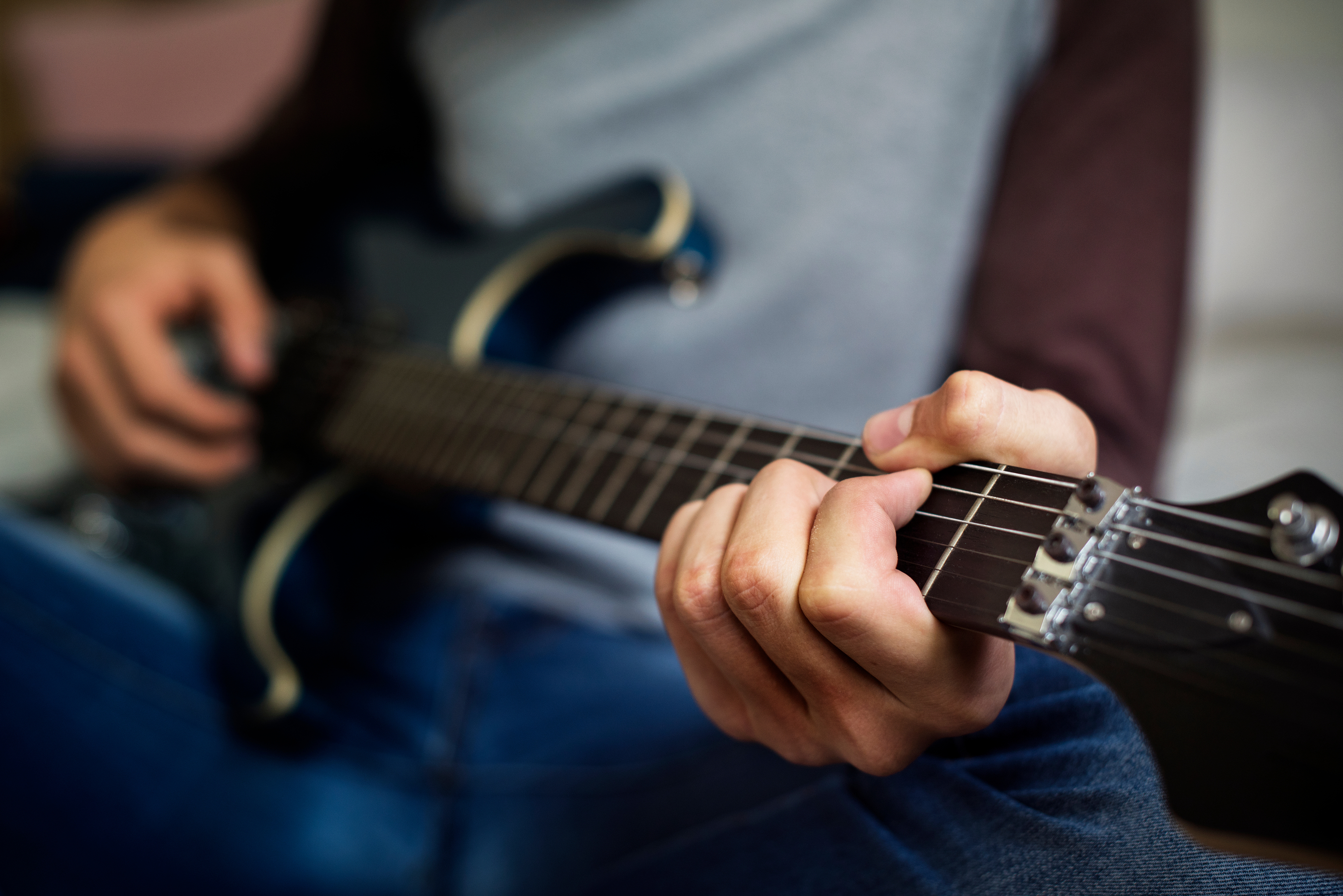 Teen playing electric guitar