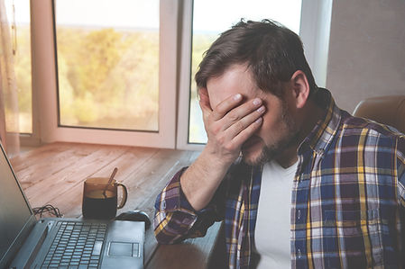 Man with head in hands frustrated with website design