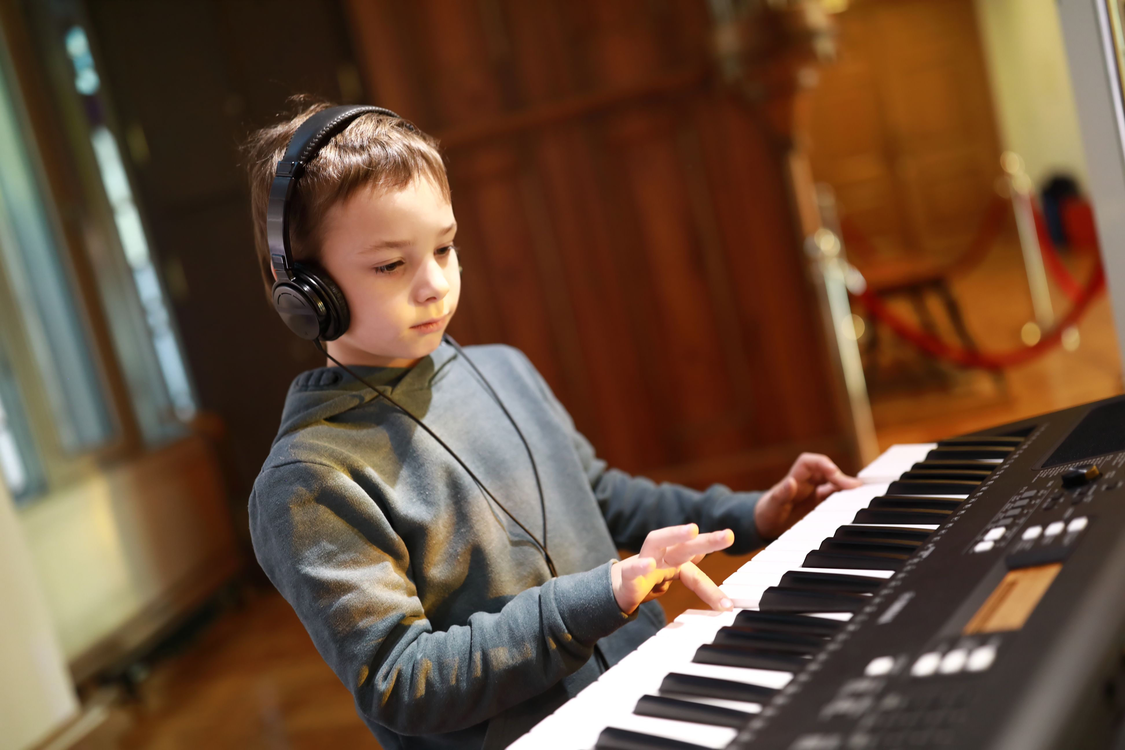Boy taking piano keyboard lessons