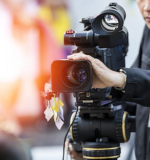 Man using professional video camera for television production