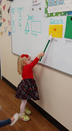 CITG Preschool girl at whiteboard