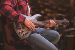 Teen playing bass guitar