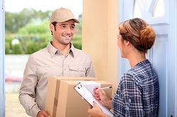 Woman accepting delivery box from man