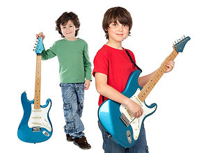 Two children takng guitar lessons