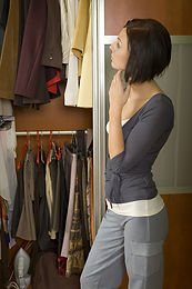 Lady looking in her closet