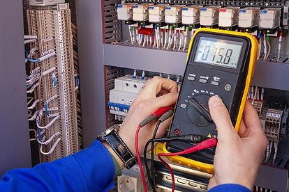 bigstock-Multimeter-In-Hands-Of-Electri-