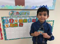 CITG Preschool boy at calendar
