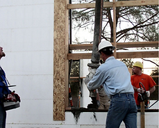 Pouring concrete in window.PNG