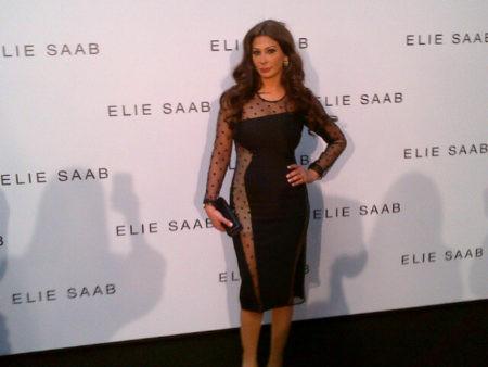 Elissa attending the Elie Saab show in Paris dress ed in a sexy black cocktail dress by British  fashion designer  Stella Mc Cartney.