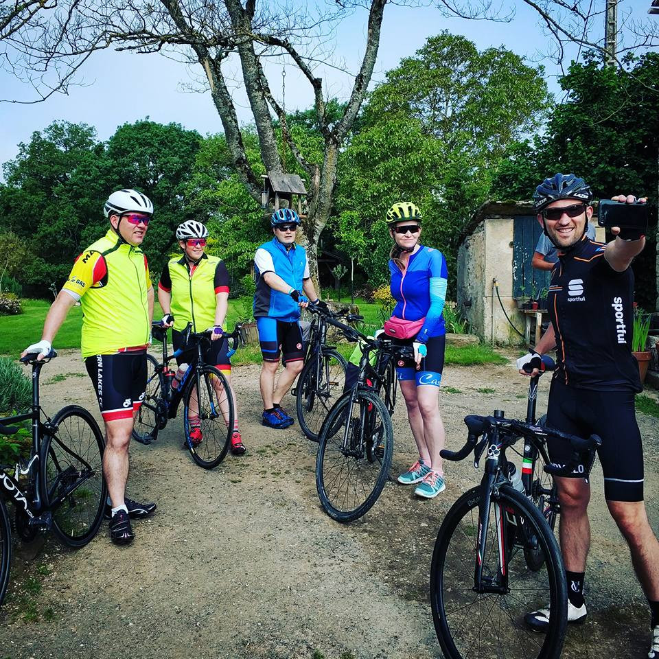 Spring cycling holiday guests gather for a pre-ride selfie