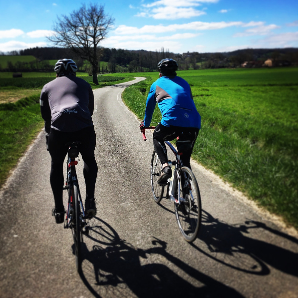 Bryan and John cycling in the Tarn near Saint Antonin Noble Val