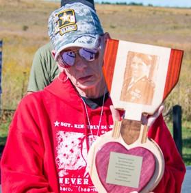 Margy Agar receiving a Purple Heart Plaq