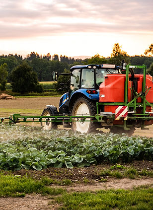 tractor-spraying-pesticides-on-cabbage-f
