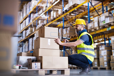 male-warehouse-worker-with-barcode-scann