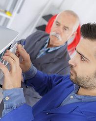 male-technician-is-repairing-a-printer-a