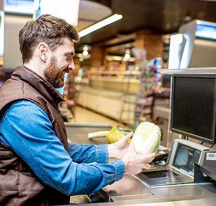 happy-cashier-at-the-cash-register-YBZ8H