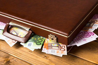 close_up_closed_suitcase_with_banknotes_