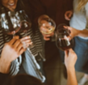 Hands holding glasses of Craft Wine
