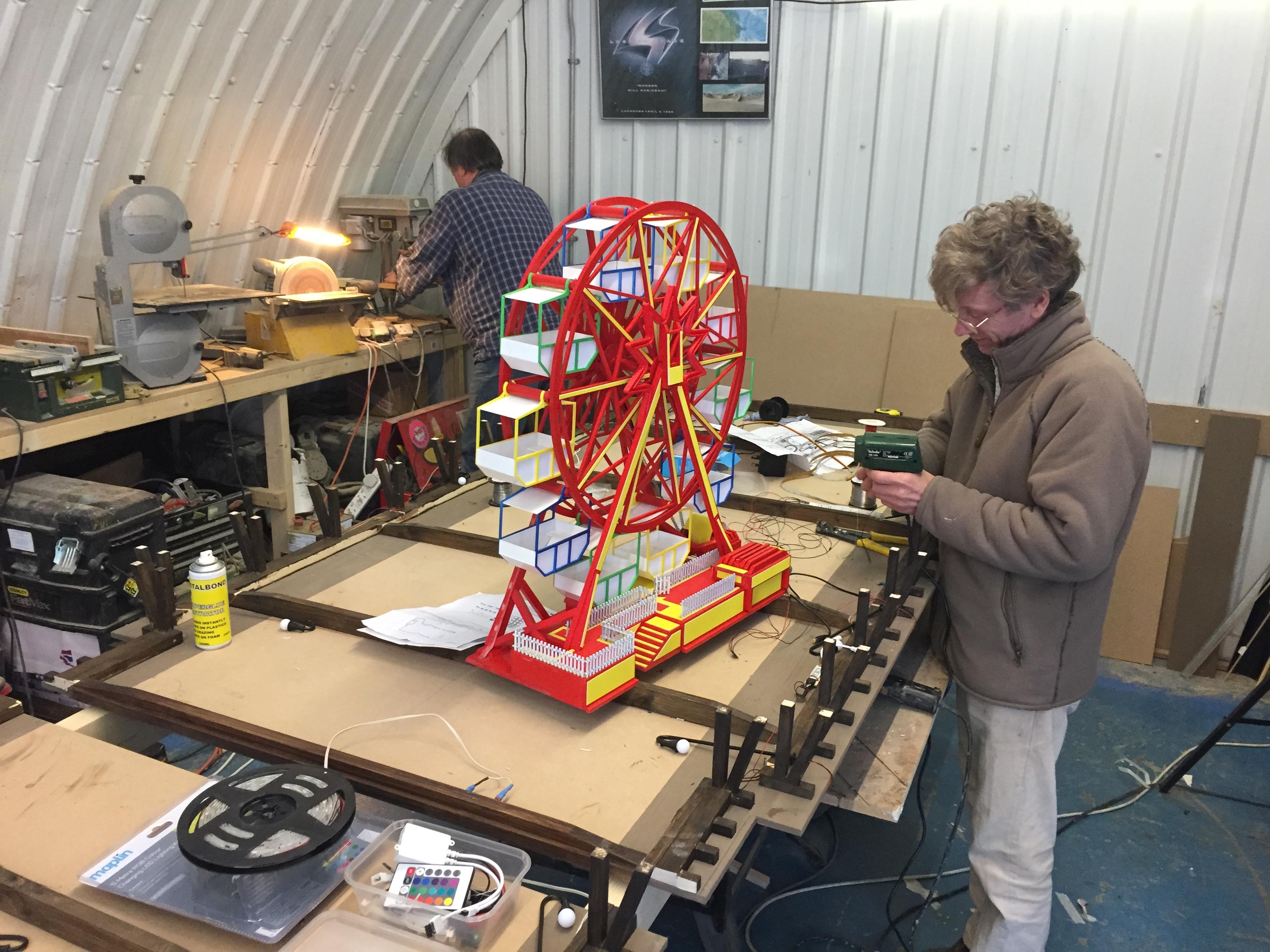 Model makers building miniatures